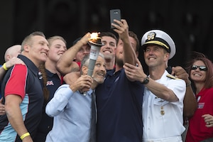 Television and movie personality, director, and writer Jon Stewart poses for a selfie with Chief of Naval Operations Adm. John M. Richardson and wounded warrior athletes during opening ceremonies for the 2017 Department of Defense Warrior Games at Soldier Field in Chicago, July 1, 2017. DoD photo by EJ Hersom