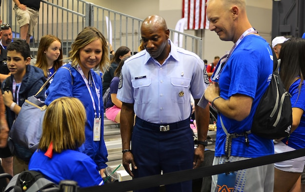 Chief Master Sgt. of the Air Force Kaleth O. Wright speaks with Staff Sgt. Melinda Smith, a finance and comptroller troop from Keyser, W.Va., at the 2017 Warrior Games July 1, 2017 at McCormick Place-Lakeside Center in Chicago. Smith will participate in archery, field, shooting and track in this year's games. (U.S. Air Force photo/Staff Sgt. Chip Pons)