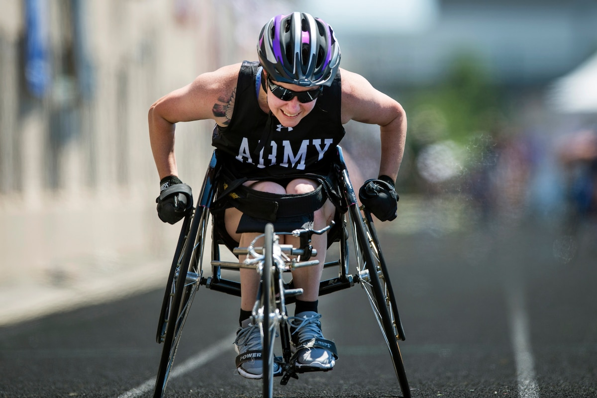 A female soldier competes in wheelchair racing.