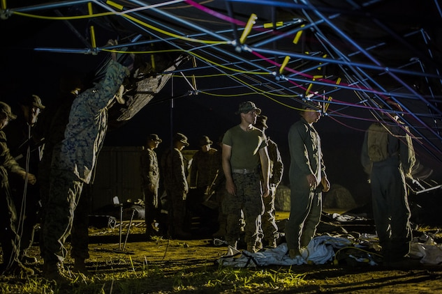 U.S. Marines attached to Marine Wing Support Squadron (MWSS) 171, based out of Marine Corps Air Station Iwakuni, break down a large tent as they prepare to move to a new location during exercise Eagle Wrath 2017 at Combined Arms Training Center Camp Fuji, Japan, June 19, 2017. Forward operating bases and forward arming and refueling points were established during the two-week exercise to train the Marines to provide explosives, weaponry, fuel, security, logistics and personnel to a forward line of troops and aircraft. (U.S. Marine Corps photo by Lance Cpl. Stephen Campbell)