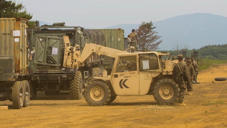 U.S. Marines attached to Marine Wing Support Squadron (MWSS) 171, based out of Marine Corps Air Station Iwakuni, load up supplies and equipment onto trucks as they prepare to move to a new location during exercise Eagle Wrath 2017 at Combined Arms Training Center Camp Fuji, Japan, June 20, 2017. Forward operating bases and forward arming and refueling points were established during the two-week exercise to train the Marines to provide explosives, weaponry, fuel, security, logistics and personnel to a forward line of troops and aircraft. (U.S. Marine Corps photo by Lance Cpl. Stephen Campbell)