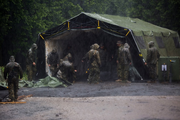 U.S. Marines attached to Marine Wing Support Squadron (MWSS) 171, based out of Marine Corps Air Station Iwakuni, set up a tent while establishing a second forward operating base during exercise Eagle Wrath 2017 at Combined Arms Training Center Camp Fuji, Japan, June 21, 2017. Forward operating bases and forward arming and refueling points were established during the two-week exercise to train the Marines to provide explosives, weaponry, fuel, security, logistics and personnel to a forward line of troops and aircraft to support Marine Aircraft Group 12 during a real deployment. (U.S. Marine Corps photo by Lance Cpl. Stephen Campbell)
