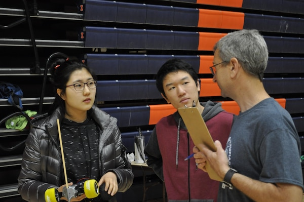 Ecologist Bruce Macallister briefs two high school participants of the Electric Vehicle Competition for the Illinois Science Olympiad State Tournament on the University of Illinois Campus, Champaign-Urbana, Ill. Macallister is with the Construction Engineering Research Laboratory in Champaign.