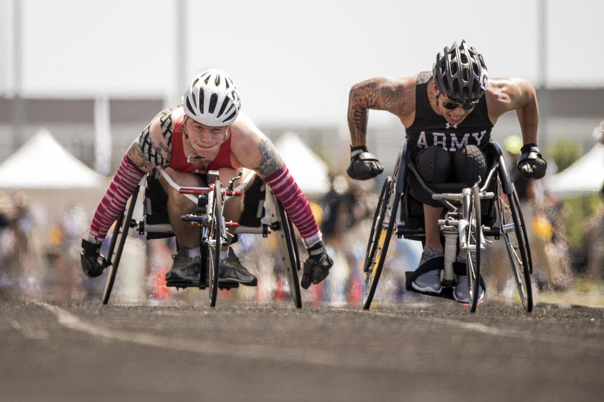 A Marine and an Army veteran compete in a wheelchair racing event