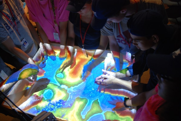 Students taking part in the SAME Camp try out the new augmented reality sandbox at ERDC's Coastal and Hydraulics Laboratory in Vicksburg June 16.