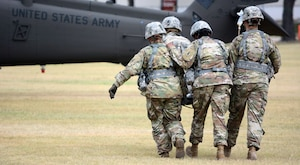 Combat Medic Soldiers from the Army Medical Department Non Commissioned Offers Academy transport an injured Soldier onto a waiting UH-60 MEDEVAC at Joint Base San Antonio-Fort Sam Houston June 30.