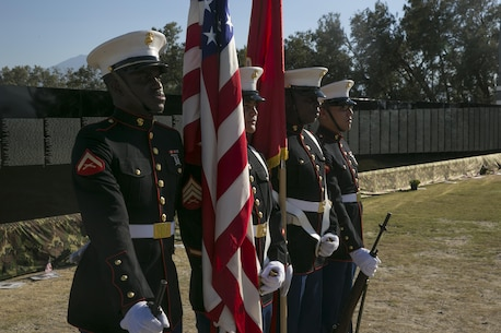 Marines with the Headquarters Battalion Color Guard prepare to present the colors during the opening program of the Moving Vietnam Veteran Memorial Wall at Mission Springs Park in Desert Hot Springs, California.
