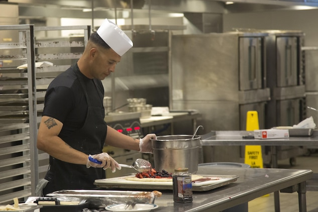 Staff Sgt. Edwin Ramirez, Chef of the Quarter participant, creates a dessert to be presented for his team during the Chef of the Quarter competition at Phelps Mess Hall aboard Marine Corps Air Ground Combat Center Twentynine Palms, Calif., June 21, 2017. The competition gave Marines and Sodexo chefs the ability to cook against each other in a friendly competition and break away from the very ridged routine schedule. (U.S. Marine Corps photo by Cpl. Thomas Mudd)