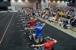 A line of archers compete in the 2017 Department of Defense Warrior Games archery competition in Chicago, July 3, 2017. The Warrior Games are an annual event allowing wounded, ill and injured service members and veterans to compete in Paralympic-style sports. DoD photo by EJ Hersom