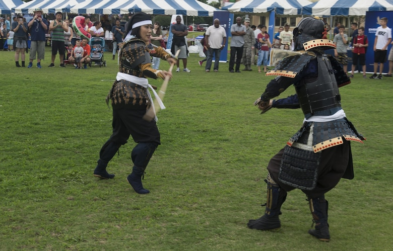Japanese performers showcase a Samurai demonstration during the Celebrate America festival at Yokota Air Base, Japan, June 30, 2017. The day kicked off with the firecracker 5K run and a wide variety of activities to include a petting zoo, dance performaces, food and fireworks. (U.S. Air Force photo by Staff Sgt. David Owsianka)