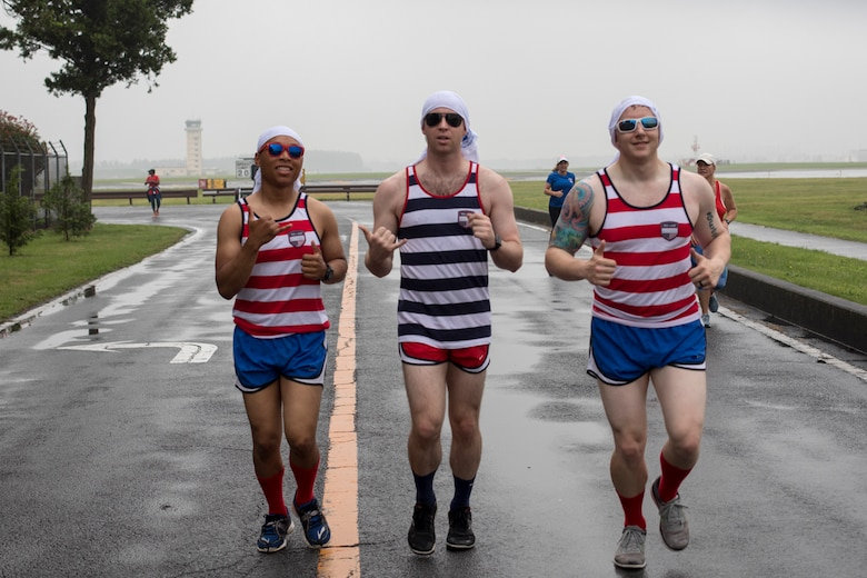 Airmen jog along the trail of the Firecracker 5K run, during the Celebrate America, June 30, 2017. Celebrate America provided Yokota personnel and their families the opportunity to relax and strengthen camaraderie while remembering America's independence. (U.S. Air Force photo by Yasuo Osakabe)