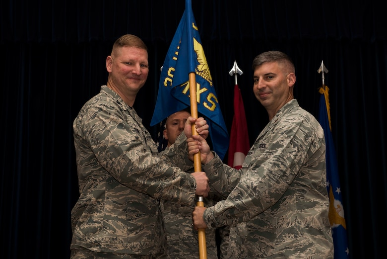 U.S. Air Force Maj. Thane Sisson (right), 39th Maintenance Squadron incoming commander, assumes command from Col. James Zirkel, 39th Weapons System Security Group commander, June 30, 2017, at Incirlik Air Base, Turkey. A change of command ceremony is a tradition that represents a formal transfer of authority and responsibility from the outgoing commander to the incoming commander. (U.S. Air Force photo by Airman 1st Class Devin M. Rumbaugh)