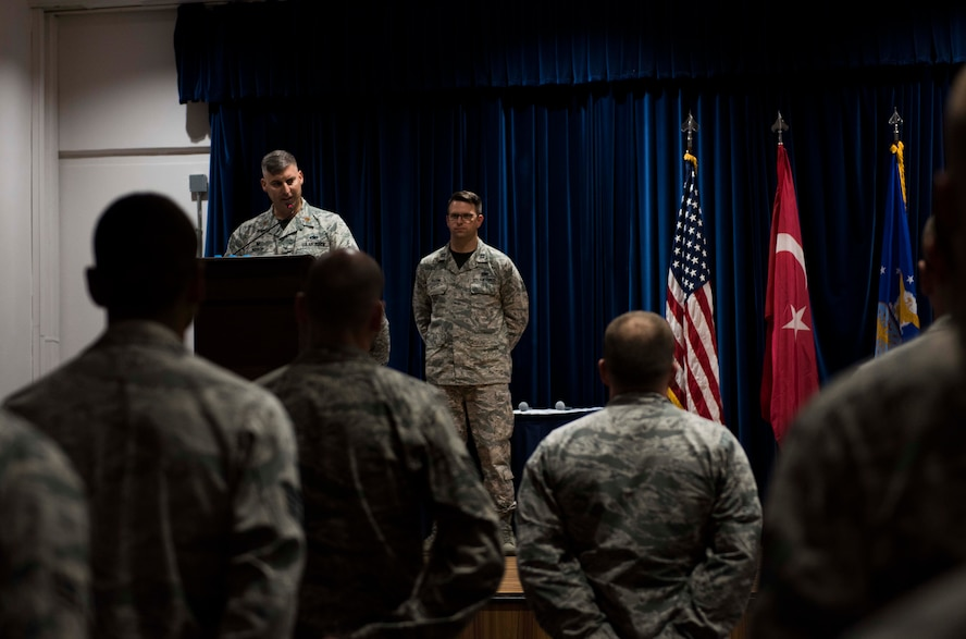 U.S. Air Force Maj. Thane Sisson, 39th Maintenance Squadron incoming commander, speaks to a group of airmen after assuming command, June 30, 2017, at Incirlik Air Base, Turkey. A change of command ceremony is a tradition that represents a formal transfer of authority and responsibility from the outgoing commander to the incoming commander. (U.S. Air Force photo by Airman 1st Class Devin M. Rumbaugh)