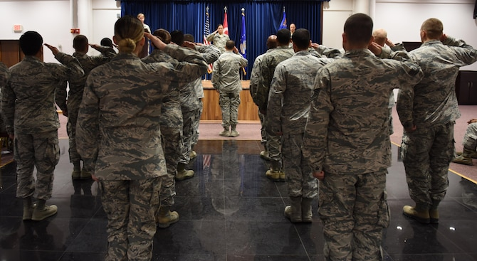 U.S. Air Force Lt. Col. Jennifer Lavergne, incoming 39th Medical Support Squadron commander, renders her first salute to the 39th MDSS airmen during a change of command ceremony June 30, 2017, at Incirlik Air Base, Turkey.  39th MDSS Airmen attended the ceremony to welcome their new commander. (U.S. Air Force photo by Senior Airman Jasmonet D. Jackson)