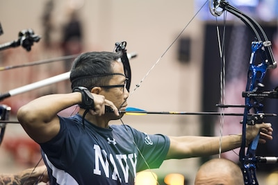 Navy Petty Officer 1st Class Romulo Urtula competes in archery during the 2017 Department of Defense Warrior Games at McCormick Place in Chicago, July 3, 2017. DoD photo by Roger L. Wollenberg