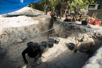 Marines and Sailors with Task Force Koa Moana 17 transport dirt in order to assist an archaeological team at a World War II mass grave excavation, June 13, 2017, in Betio Island, Tarawa Atoll, Kiribati. The Marines and Sailors that assisted were unable to work with the fragile bones of the deceased, so they assisted with back-filling holes and transporting dirt.  No photos of the remains were taken in order to respect the deceased and their families.