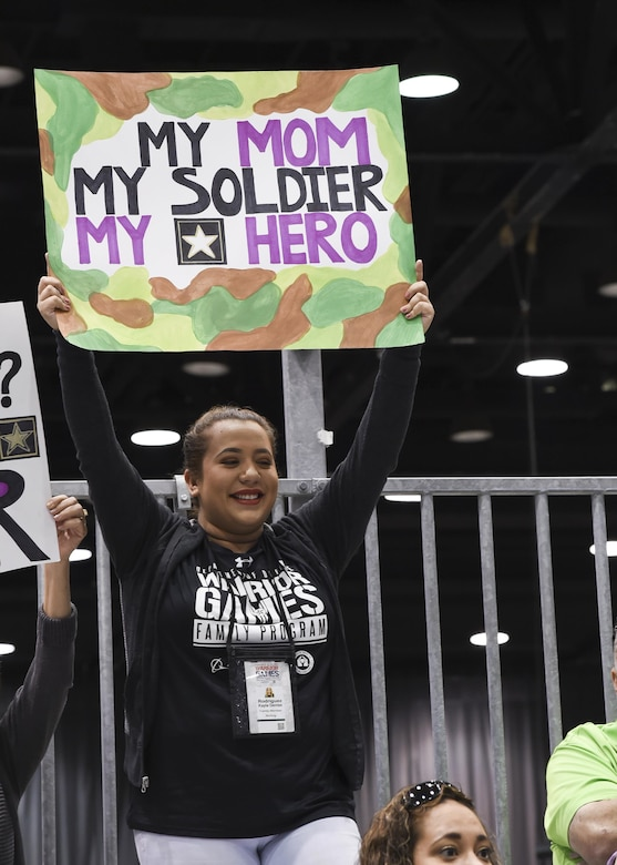 Kayla Rodriguez cheers for her mother, Michelle Sanchez, during the archery competition for the 2017 Department of Defense Warrior Games at McCormick Place in Chicago, July 3, 2017. Navy photo by Seaman Perla Landa