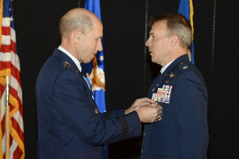 Gen. Mike Holmes, commander, Air Combat Command, presents retired Air Force Lt. Col. Gregory Thornton with the Silver Star medal during a ceremony at the National Museum of the United States Air Force in Dayton, Ohio, June 30, 2017. Thornton received the Silver Star for his actions on April 6, 2003 while supporting 'Advance 33,' the call sign for a ground forward air controller attached to Task Force 2nd Battalion, 69th Armor, during combat operations in Iraq. The Silver Star is the third-highest combat decoration for gallantry in action that can be awarded to a member of the United States Armed Forces. (U.S. Air Force photo by Wesley Farnsworth)
