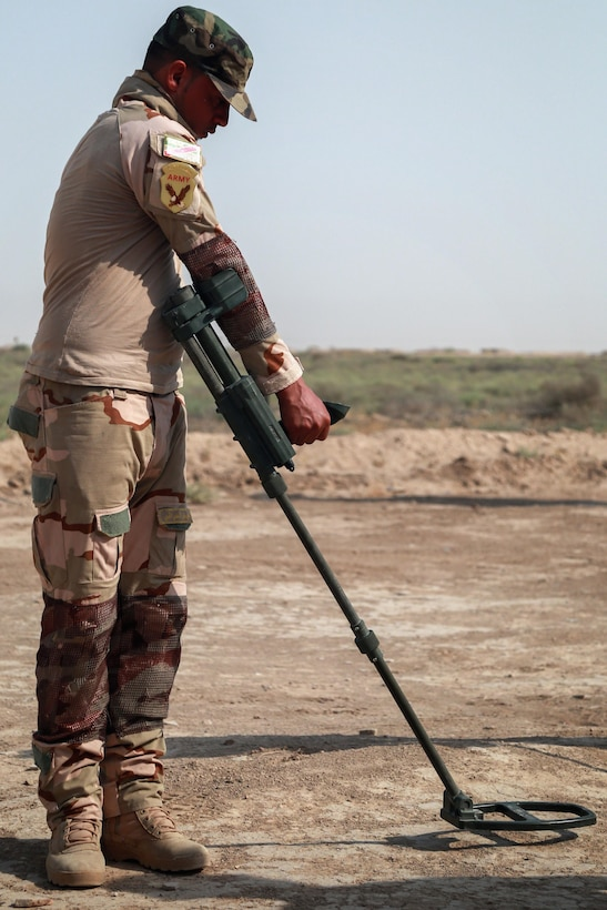 An Iraqi army soldier uses a Vallon metal detector during mine detection  training for the Iraqi army at the Besmaya Range Complex Iraq, July 2, 2017. This training is part of the overall Combined Joint Task Force - Operation Inherent Resolve building partner capacity mission which focuses on training and improving the capability of partnered forces fighting ISIS. CJTF-OIR is the global Coalition to defeat ISIS in Iraq and Syria. (U.S. Army photo by Cpl. Tracy McKithern)