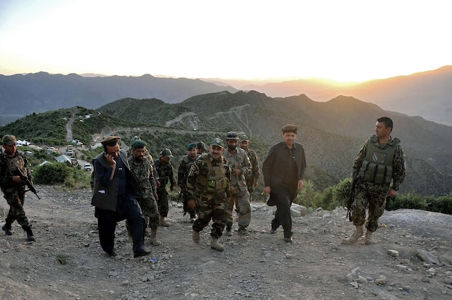 "Brig. Gen. Abdul Wasea Milad,(center of photo) Commander of ANA 203rd ""Thunder"" Corps inspects operations May 21 in Dand-e-Patan district of southeastern Afghanistan during operations to secure routes through the Spin Ghar ""White Mountain"" range. (Afghanistan National Army photo provided by 203rd Police Zone PAO.)"