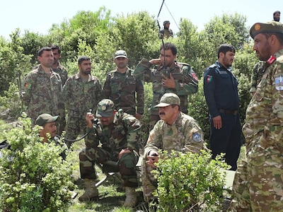 """Brig. Gen. Abdul Wasea Milad,(Seated left) Commander of ANA 203rd """"Thunder"""" Corps and Maj. Gen. Asadullah Shirzad, (Seated right) Commander of ANP 303rd Police Headquarters Zone  inspects operations May 21 in Dand-e-Patan district of southeastern Afghanistan during operations to secure routes through the Spin Ghar """"White Mountain"""" range. (Afghanistan National Police photo provided by 303rd Police Zone PAO.)"""