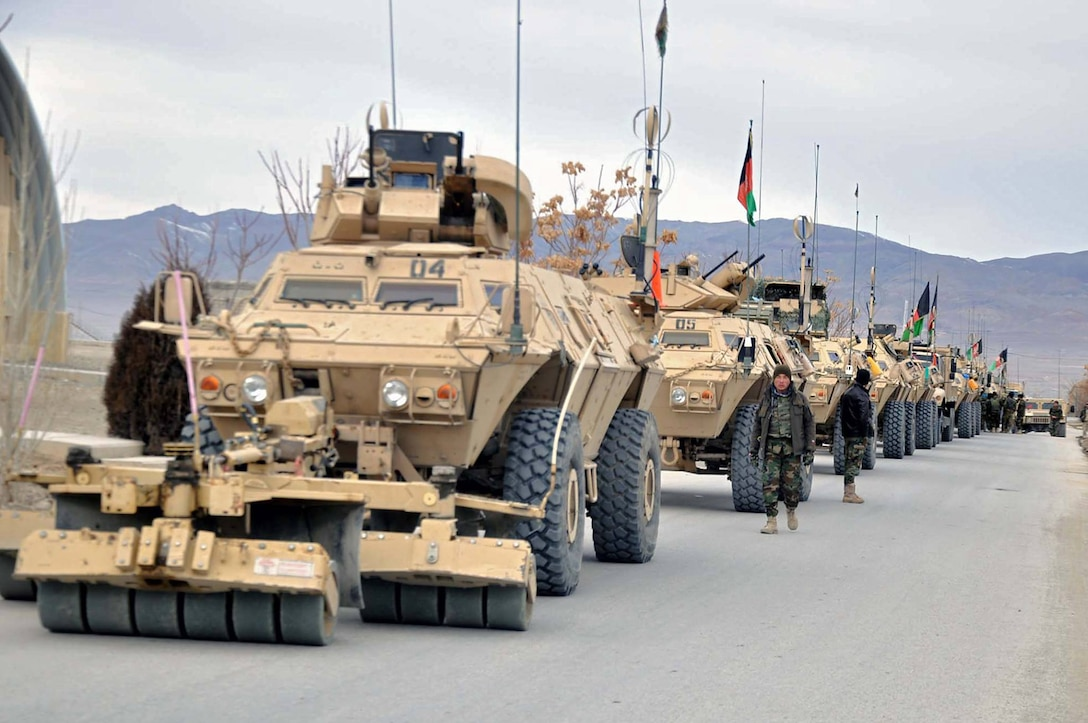 "Afghanistan National Army Soldiers from 203rd ""Thunder"" Corps based out of FOB Thunder in Gardez, Afghanistan assemble for convoy-route clearance operations May 25 in Tagab district of Ghazni province. (Afghanistan National Army photo provided by 203rd Corps PAO.)"