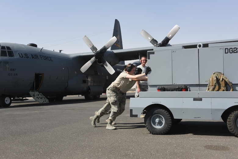 U.S. Air Force Academy Cadets Elizabeth Hartman and Lionel Gumireddy push a generator cart away from a C-130 Hercules in preparation for its take-off at an undisclosed location in Southwest Asia, June 27, 2017. The U.S. Air Force Academy cadets are deployed to the 386th Air Expeditionary Wing as part of the academy's Operation Air Force program, which exposes cadets to a variety of career fields to aid them in their future career selections. (U.S. Air Force photo by Tech. Sgt. Jonathan Hehnly)