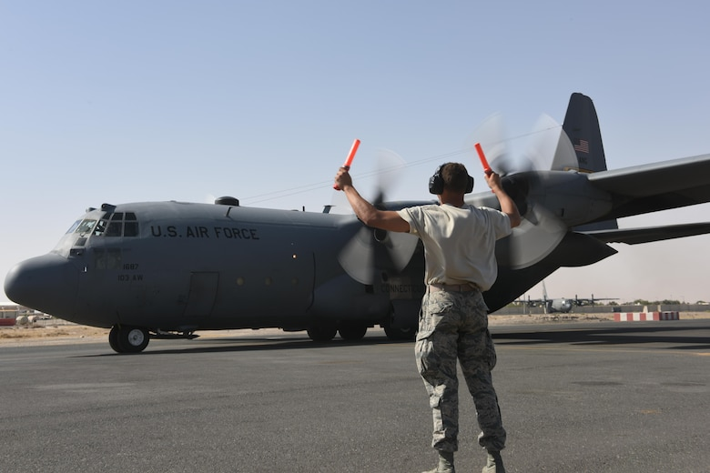 U.S. Air Force Academy Cadet Trey Griffin marshals a C-130 Hercules as it starts to taxi at an undisclosed location in Southwest Asia, June 27, 2017. The U.S. Air Force Academy cadets are deployed to the 386th Air Expeditionary Wing as part of the academy's Operation Air Force program, which exposes cadets to a variety of career fields to aid them in their future career selections. (U.S. Air Force photo by Tech. Sgt. Jonathan Hehnly)
