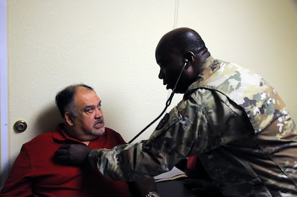 Lt. Col. Jude Momodu, a family physician and commander of 7229th Medical Support Unit located in Nashville, Tennessee, works with local residents at La Teresita community center.  Momodu is one of approximately 125 U.S. Army Reserve Soldiers who are working in partnership with the Texas A&M Colonias program to provide medical care to Webb County's under-served Colonias population. Services provided by Army Reserve personnel are done through the Department of Defense's Innovative Readiness Training, a civil-military program that builds mutually beneficial partnerships between U.S. communities and the DoD. The missions selected meet training & readiness requirements for Army Reserve service members while integrating them as a joint and whole-of-society team to serve our American citizens.