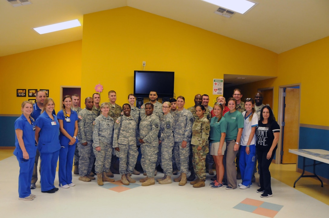 Twenty-five Army Reserve Soldiers assigned to 7458th Medical Backfill Bn. work alongside medical students from Texas A&M University to provide medical support to residents who live near La Teresita community center in Laredo, Texas.  Soldiers working at La Teresita are part of a larger medical team of approximately 125 U.S. Army Reserve Soldiers who are working in partnership with the Texas A&M Colonias program to provide medical care to Webb County's under-served Colonias population. Services provided by Army Reserve personnel are done through the Department of Defense's Innovative Readiness Training, a civil-military program that builds mutually beneficial partnerships between U.S. communities and the DoD. The missions selected meet training & readiness requirements for Army Reserve service members while integrating them as a joint and whole-of-society team to serve our American citizens.