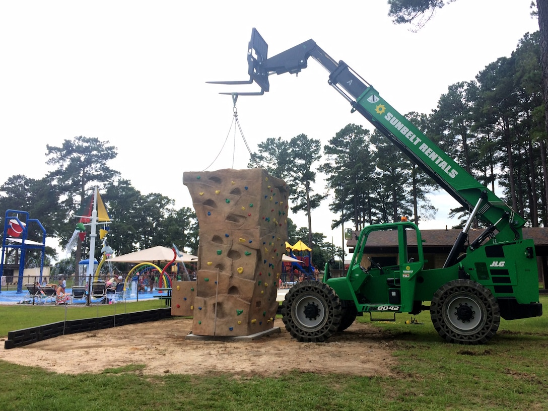 Members of the 4th Civil Engineer Squadron assemble a bouldering rock near Debden Park, June 27, 2017, at Seymour Johnson Air Force Base, North Carolina. For more information about the equipment call Outdoor Recreation at 919-722-1104.  (Courtesy photo)