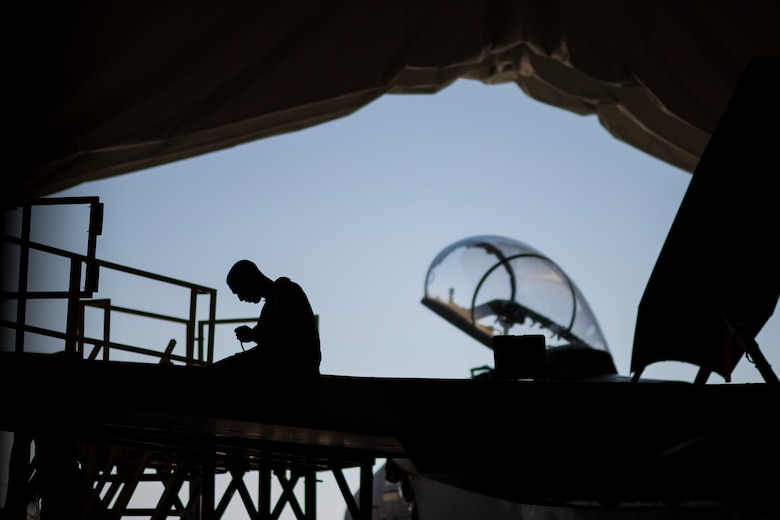Airman 1st Class Joshua Anthony332nd Expeditionary Maintenance Squadron inspection section journeyman, works on an F-15E Strike Eagle assigned to the 332nd Air Expeditionary Wing, June 16, 2017, in Southwest Asia. F-15Es undergo detailed inspections and maintenance every 400 hours of flight, ensuring the 332nd AEW's continued support of Operation Inherent Resolve. (U.S. Air Force photo/Senior Airman Damon Kasberg)