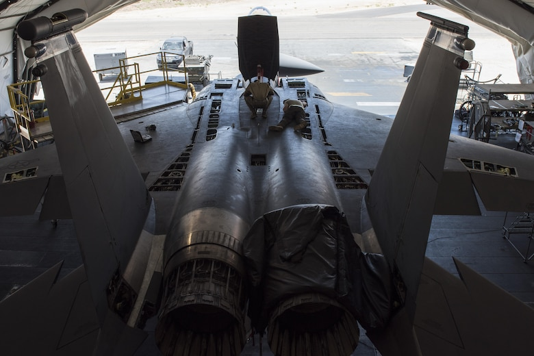 Airmen assigned to the 332nd Expeditionary Maintenance Squadron work on an F-15E Strike Eagle assigned to the 332nd Air Expeditionary Wing, June 16, 2017, in Southwest Asia. The maintainers separate the aircraft into five sections, allowing them to complete their inspection and maintenance in less time. (U.S. Air Force photo/Senior Airman Damon Kasberg)