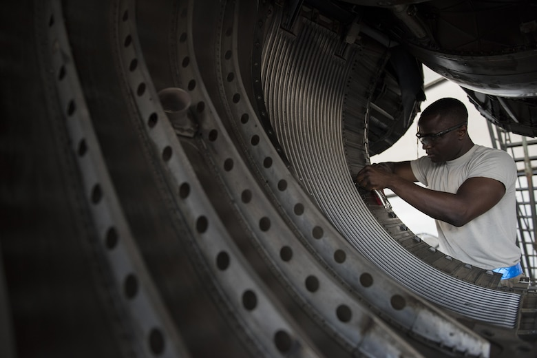 Senior Airman Babatunde Olatinwo, 332nd Expeditionary Maintenance Squadron aircraft structural maintenance journeyman, repairs a worn panel on an F-15E Strike Eagle, June 16, 2017, in Southwest Asia. F-15Es undergo detailed inspections and maintenance every 400 hours of flight. (U.S. Air Force photo/Senior Airman Damon Kasberg)