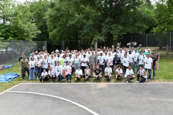 Over 200 Volunteers from the 70th Intelligence, Surveillance and Reconnaissance Wing, National Capitol Region service members, Rebuilding Together Ann Arundel County and CBRE pose for a group photo during the initial rebuilding of a local neighborhood June 16, 2017 in Bowie, Md In a recent initiative, RTAAC created a three-year project to repair homes for low-income residents in need within the county. (U.S. Air Force photo/Staff Sgt. Alexandre Montes)