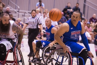Air Force Tech. Sgt. Brian Williams tracks a loose basketball during the wheelchair basketball preliminary game during 2017 Department of Defense Warrior Games at McCormick Place-Lakeside Center in Chicago, June 30, 2017. Air Force photo by Staff Sgt. Keith James