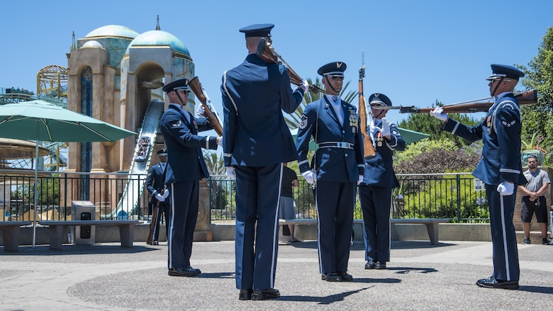 The U.S. Air Force Honor Guard Drill Team performs in front of the Sea World ride Atlantis in San Diego, Ca., June 27, 2017. The drill team promotes the Air Force mission worldwide by showcasing performances at public and military venues to recruit, retain, and inspire future and current Airmen. (U.S. Air Force photo by Senior Airman Jordyn Fetter)