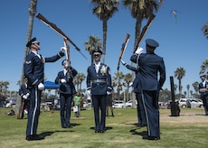 The U.S. Air Force Honor Guard performs a flash drill at Mission Beach, Ca., June 27, 2017. This impromptu performance of a routine drill is implemented to surprise the public with the team's disciplined and coordinated military movements. The flash drill was the team's second performance during their six-day trip throughout southern California. (U.S. Air Force photo by Senior Airman Jordyn Fetter)