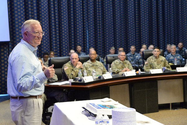 DLA Joint Reserve Force Deputy Director Robert McCullough speaks to attendees during the Combined Drill Weekend event June 10 at the McNamara Headquarters Complex, Fort Belvoir, Va. McCullough retired June 30 after 19 years of dedicated service to the organization.