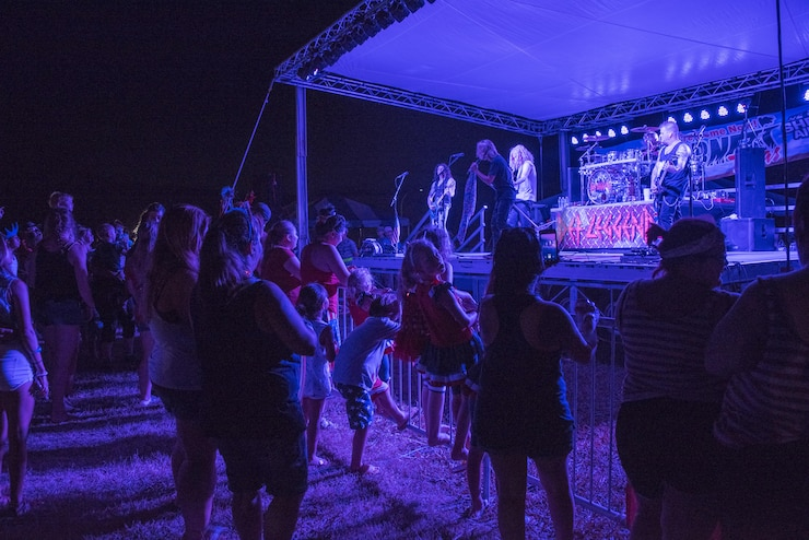 Guests who attended the Sheppard Air Force Base, Texas, Freedom Fest, enjoyed live tunes performed by Def Leggend, a Def Leppard tribute band, July 4, 2017. Thousands of Texomans filled the base to enjoy Freedom Fest; a free event which featured three live bands, aircraft displays, food trucks galore, and an extravagant firework display to cap off the evening. (U.S. Air Force photo by Staff Sgt. Kyle E. Gese)
