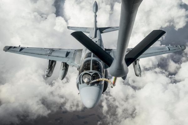 A Marine Corps EA-6B Prowler receives fuel from an Air Force KC-135 Stratotanker in an undisclosed location, July 1, 2017, while supporting Operation Inherent Resolve. Air Force photo by Staff Sgt. Michael Battles