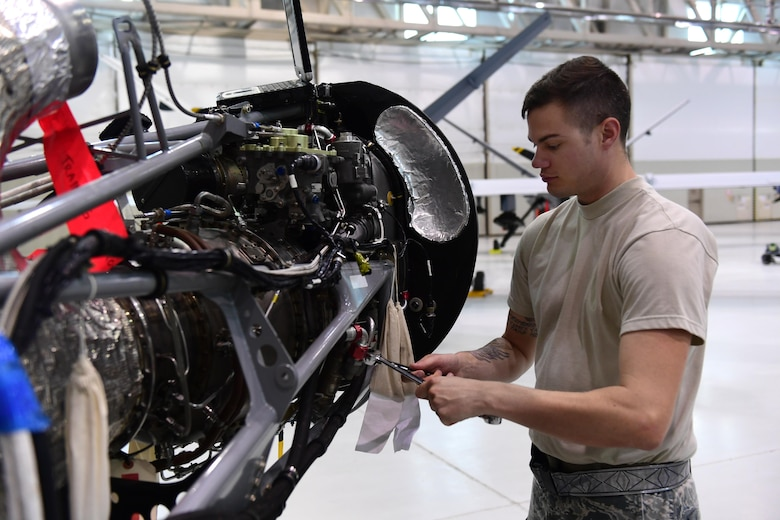 Staff Sgt. Joshua, 432nd Aircraft Maintenance Squadron MQ-9 Reaper crew chief, uses an engine trainer to refresh his skills June 19, 2017, at Creech Air Force Base, Nev. The engine trainer can be programmed to display certain errors which maintainers must correct. (U.S. Air Force photo/Senior Airman Christian Clausen)