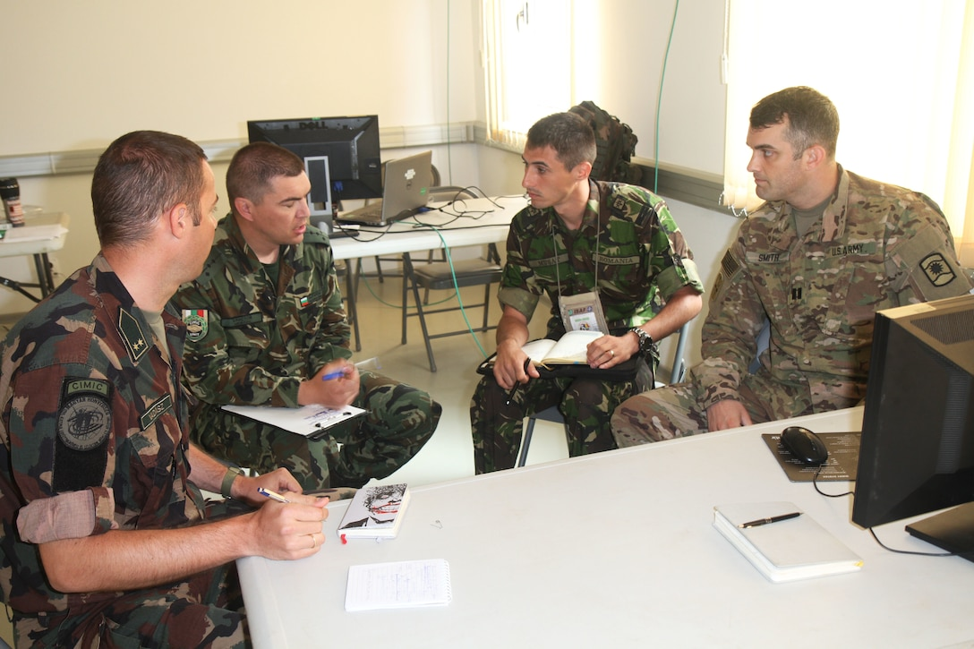 From left to right, 1st Lt. Mark Vadasz, Hungarian Civil Military Cooperation (CIMIC), Capt. Philip Hristov, Bulgarian CIMIC, 1st Lt. Musat Cosmin, Romanian CIMIC, with Capt. Anthony W. Smith, lead exercise planner from 361st Civil Affairs Brigade, sit together to plan future civil engagements for Saber Guardian 17 (SG17) in Novo Selo Training Area, Bulgaria on July 4, 2017. 361st CA BDE is responsible for conducting civil engagements and activities to promote transparency and the relationship between U.S. forces, civilian authorities and civilian populations during SG17 (U.S. Army photo by Sgt. Charity Boedeker, 361st CA BDE Public Affairs).