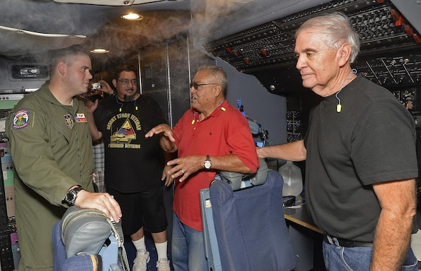 """Staff Sgt. Eric Ganley, 68th Airlift Squadron engineer, takes questions form veterans from  Camino Real Community Services as they tour a C-5M Super Galaxy aircraft June 30, 2017 at Joint Base San Antonio-Lackland, Texas. CRCS is a Veteran informed agency that provides """"peer to peer"""" outreach and support to veterans and their families. (U.S. Air Force photo by Benjamin Faske)"""