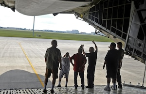 """Staff Sgt. Cole Lance, 68th Airlift Squadron load master, shows veterans from Camino Real Community Services the aft load ramp on a C-5M Super Galaxy aircraft June 30, 2017 at Joint Base San Antonio-Lackland, Texas. CRCS is a Veteran informed agency that provides """"peer to peer"""" outreach and support to veterans and their families. (U.S. Air Force photo by Benjamin Faske)"""