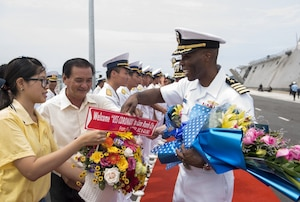 Commodore, Destroyer Squadron 7 Capt. Lex Walker is greeted by senior Vietnam People's Navy officials during the opening ceremony for Naval Engagement Activity (NEA) Vietnam 2017 at Cam Ranh International Port, July 5. The engagement provides an opportunity for Sailors from the U.S. and Vietnam People's Navy to interact and share knowledge to enhance mutual capabilities and strengthen solid partnerships.
