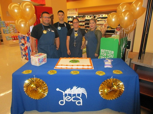 Employees of the Laughlin Commissary present an anniversary cake at Laughlin Air Force Base, Tx., July 1, 2017.  The cake was a part of the store's celebration for the Defense Commissary Agency's 150th anniversary.