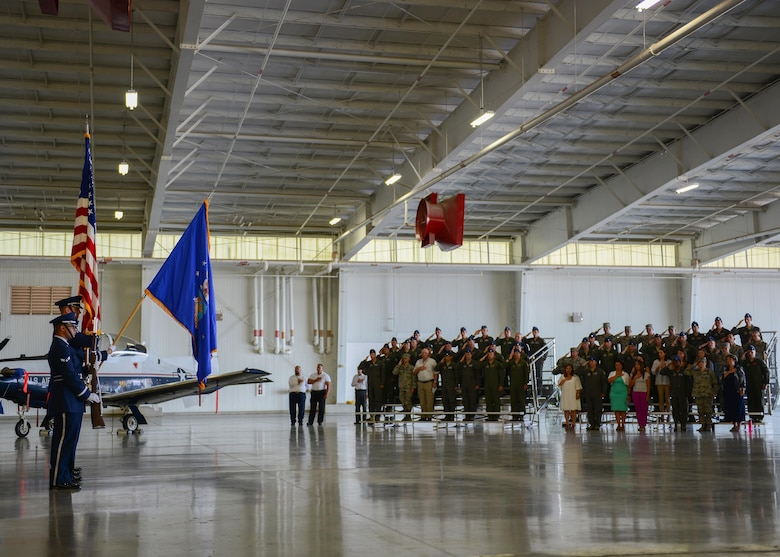 Laughlin Air Force Base Honor Guard members present the colors during the 47th Operations Group Assumption of Command at Laughlin Air Force Base, Tx., June 22, 2017. The base community gathered to welcome U.S. Air Force Col. Robert Pekarek as the new 47th OG commander. (U.S. Air Force photo/Airman 1st Class Benjamin N. Valmoja)