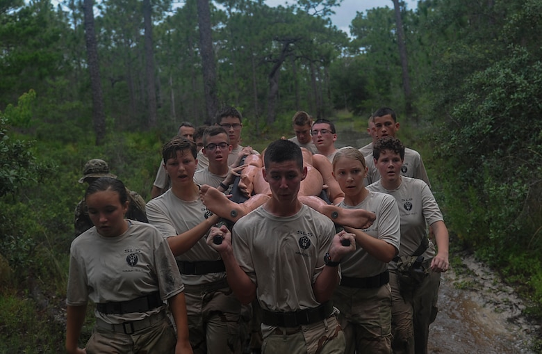 Junior ROTC cadets litter carry a simulated patient during a Monster Mash at Hurlburt Field, Fla., June 30, 2017. The JROTC Summer Leadership School brought more than 50 cadets to Hurlburt Field to engage in a variety of team-building and leadership skill-developing exercises under the guidance of Air Commandos, June 26 through 30. (U.S. Air Force photo by Airman 1st Class Rachel Yates)