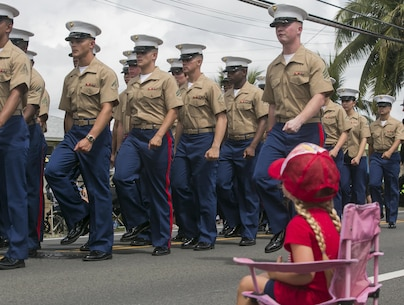 KAILUA, Hawaii -- A local Kailua girl watches Marines from Marine Corps Base Hawaii march by during the 71st annual Kailua Independence Day Parade July 4, 2017. Stretching down Kainalu Drive, the parade featured both active duty and retired military service members, along with floats from many local businesses and organizations to celebrate America's freedom and independence. (U.S. Marine Corps photo by Lance Cpl. Luke Kuennen)